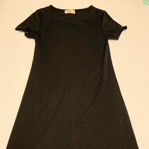 Black tshirt dress with cutouts at the bottom